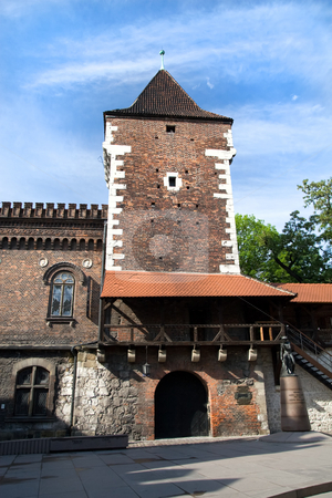 Medieval Fortifications in Cracow stock photo, Medieval fortifications, tower and part of the wall in Cracow, Poland. by Rognar