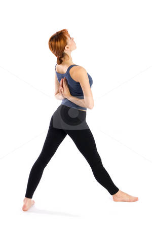 Woman doing Yoga Exercise stock photo, Woman in opening pose for yoga exercise called Parsvottanasana, isolated on white background. by Rognar