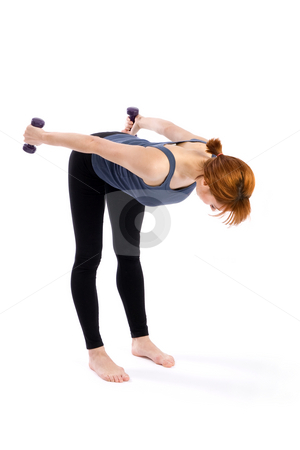 Fitness Woman Exercise stock photo, Young fitness woman doing aerobic exercise with dumbbells, isolated on white. by Rognar