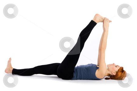 Woman doing Stretching Yoga Exercise stock photo, Young attractive woman doing stretching yoga exercise called Supta Padangusthasana, isolated on white background. by Rognar