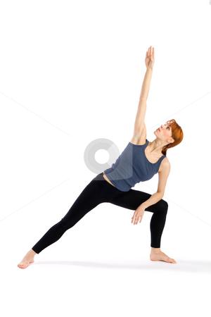 Young Woman Yoga Exercise stock photo, Woman doing Yoga exercise called Parsvakonasana (Extended Side Angle Pose - Parsvakonasana), isolated on white background. by Rognar