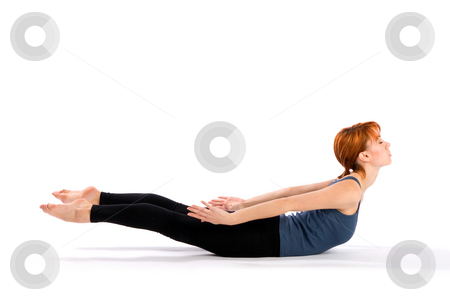 Slim Young Woman doing Yoga Exercise stock photo, Young slim woman doing yoga exercise called Salabhasana, isolated on white background. by Rognar