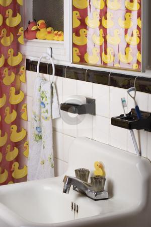 Rubber ducky bathroom stock photo, Appartment bathroom decorated with a rubber duck theme by Yann Poirier
