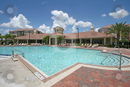 Swimming Pool stock photo, A Large Swimming Pool in Sunny Florida by Lucy Clark
