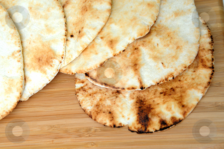 Pita Bread stock photo, Six middle eastern flat bread disks stacked on top of each other. by Lynn Bendickson