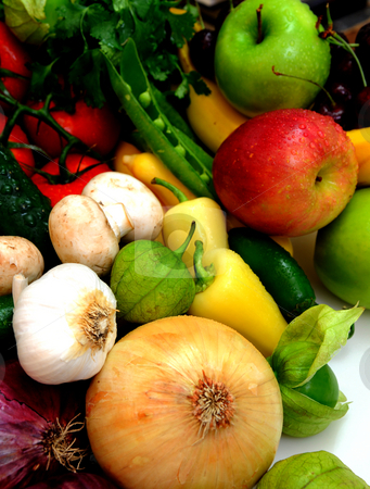Vegtables And Fruit stock photo, Assorted fresh fruit and vegetables with onions, garlic an tomatillos in the foreground by Lynn Bendickson