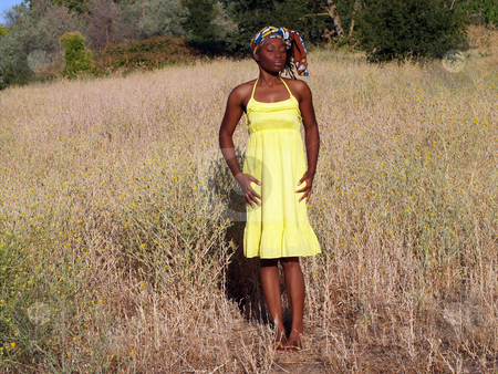 Young black woman outdoors in yellow dress stock photo, Outdoor black woman in yellow dress eyes closed by Jeff Cleveland