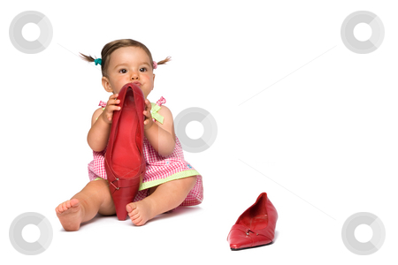 Baby Girl and Big Red Shoes stock photo, One year old baby girl using shoes as toys, isolated on white background. by Rognar