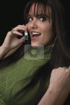 Fashion model - Cell phone stock photo, Twenty something fashion model smiling with a cell phone in hand by Yann Poirier