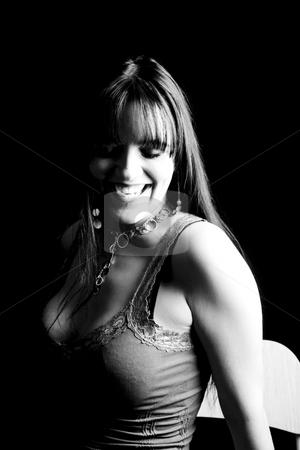 Fashion model - Big smile stock photo, Twenty something fashion model sitting with big smile by Yann Poirier