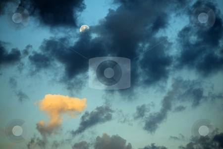 Moon and clouds in sunrise stock photo, Moon and clouds in sunrise, one of clouds illuminated by rising Sun by Juraj Kovacik