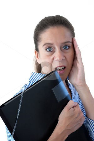 Middle Aged Business Woman Looking Shocked with File stock photo, Middle aged business woman looking shocked holding a black file on a white background by Keith Wilson