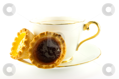 Tea and Jam Tarts stock photo, Tea in a cup and saucer with yellow and red jam tarts on a white background by Keith Wilson