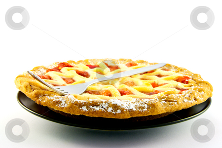 Whole Apple and Strawberry Pie with a Fork stock photo, Whole apple and strawberry pie on a black plate with a fork on a white background by Keith Wilson