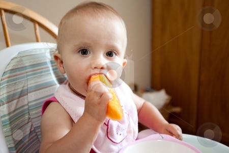 Baby eating cantaloupe stock photo, Cantaloupe  refers to two varieties of (Cucumis melo)  which is a species in the family Cucurbitaceae by Mariusz Jurgielewicz