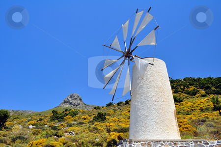 Wind mill in Crete stock photo, Traditional wind mill in the Lassithi plateau, Crete. by Fernando Barozza