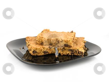 Chocolate chip cookie bars stock photo, Chocolate chip cookie bars on a black plate by John Teeter