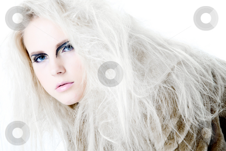 High fashion make-up girl looking at you stock photo, Model with white hair in a high fashion pose looking curious at the viewer.