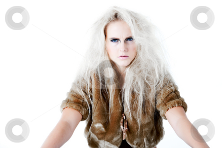 What do you think will be my next move stock photo, Model with wild white hair in a waiting pose with a fierce look.