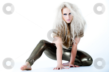 Waiting to attack you with muy next move stock photo, Model in a stretched waiting pose looking fierce.