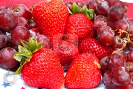 Delicious fruit stock photo, Delicious fruit, ripe strawberries and purple grapes by Shirley Mathews