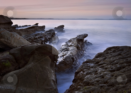 St Mary Cathedral stock photo, Long exposure shot of volcanic basalt outcrops on Auckland's North Shore by Robin Ducker
