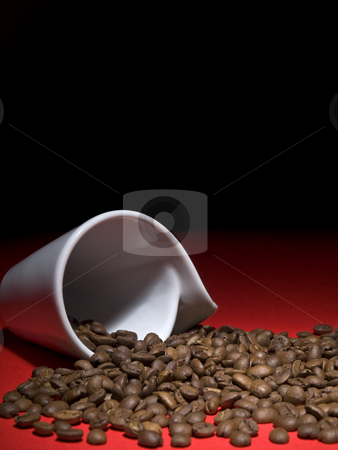 Coffee beans stock photo, A fallen cup with coffee beans spread out. by Ignacio Gonzalez Prado