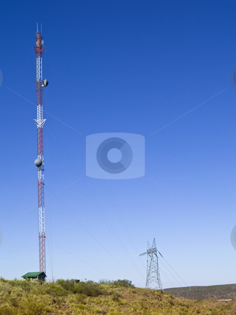 Cellular antenna stock photo, Cellular communication antenna on a blue sky background. by Ignacio Gonzalez Prado
