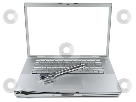 Computer maintenance stock photo, A spanner over a damaged laptop isolated over white background. White copy space on screen. by Ignacio Gonzalez Prado