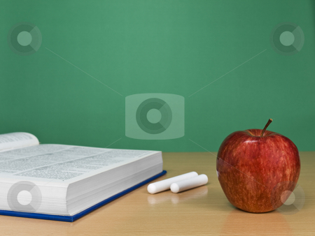 Blank chalkboard stock photo, A blank chalkboard with an apple, a book and some chalks. by Ignacio Gonzalez Prado