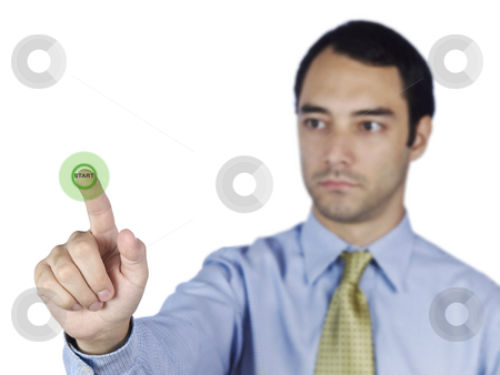 Starting bussiness stock photo, Young business man touching a start button on the screen. by Ignacio Gonzalez Prado