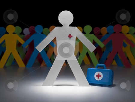 Paper doctor stock photo, A paper doctor stands on the spotlight with his suitcase. Multicolor crew on the background. by Ignacio Gonzalez Prado