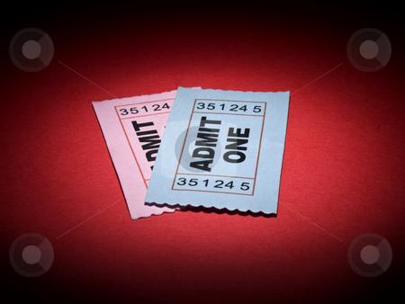 Movie stub stock photo, Close up shot of two generic admission tickets over red background. by Ignacio Gonzalez Prado