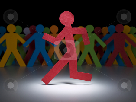 The running man stock photo, A red paper figure runs under the spotlight in front of a multicolor crew. by Ignacio Gonzalez Prado