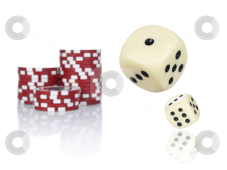 Rolling dices stock photo, Pair of dice rolling in front of stacked red poker chips. by Ignacio Gonzalez Prado