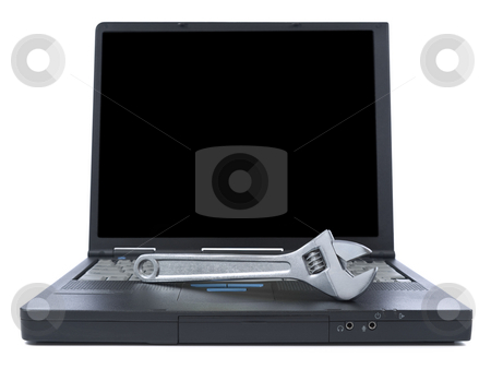 Technical support stock photo, A spanner over a black laptop isolated over white background. Black copy space on screen. by Ignacio Gonzalez Prado