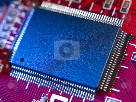Memory chip stock photo, Close up on a memory chip in a red computer circuit board. by Ignacio Gonzalez Prado