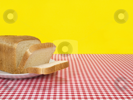 Fresh bread stock photo, A loaf of bread sliced and served on the table. by Ignacio Gonzalez Prado