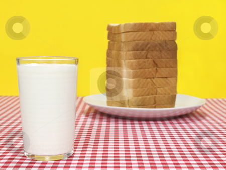 Milk and bread stock photo, A glass of milk and a sliced loaf of bread. by Ignacio Gonzalez Prado