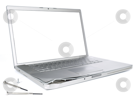 Damaged laptop stock photo, A damaged laptop computer is about to be fixed with a pair of clockwork screwdrivers. Isolated on white. by Ignacio Gonzalez Prado