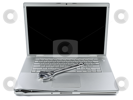 Computer maintenance stock photo, A spanner over a damaged laptop isolated over white background. by Ignacio Gonzalez Prado