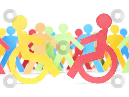 Handicap paper people stock photo, Two paper men on wheelchair. Multicolor paper crew on the background. by Ignacio Gonzalez Prado