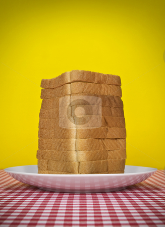 Bread tower stock photo, Sliced loaf of bread served on a table. by Ignacio Gonzalez Prado