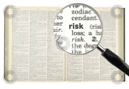 Searching for RISK stock photo, A magnifying glass on the word RISK on a dictionary. by Ignacio Gonzalez Prado