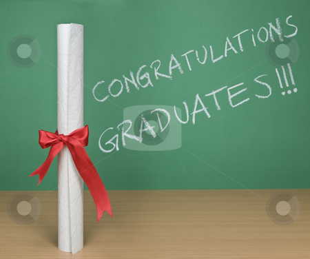 Congratulations graduates stock photo, Congratulations graduates written on a chalkboard with a diploma on forefround. by Ignacio Gonzalez Prado