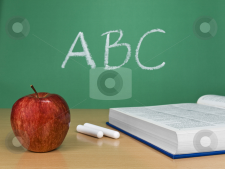 ABC stock photo, ABC written on a chalkboard with an apple, a book and some chalks. by Ignacio Gonzalez Prado
