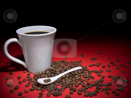 Coffee and beans stock photo, A cup of tasty coffee and some coffee beans spread arround. by Ignacio Gonzalez Prado