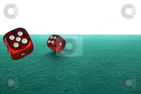 Dices rolling stock photo, Two red dices rolling over a green felt against a white background. by Ignacio Gonzalez Prado