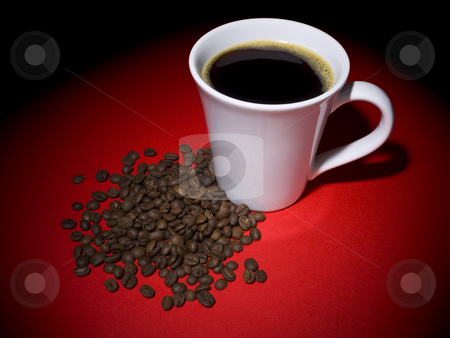 Coffee and beans stock photo, A cup of tasty coffee and some coffee beans aside. by Ignacio Gonzalez Prado