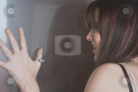 Fashion model - growling stock photo, Twenty something fashion model growling at window by Yann Poirier